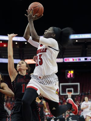 Louisville's Jazmine Jones goes up for a shot against SEMO's Jessie Harshberger.