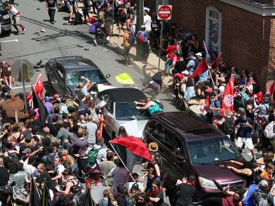 A gray Dodge plowed into pedestrians and vehicles on the mall in Charlottesville after Saturday's white supremacist rally. The driver hit the knot of cars and people at high speed, then backed up and fled the scene. Serious, maybe life-threatening injuries to several people.