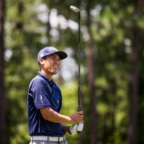 Justin Martinson watches a tee shot during an NGA Tour event last July in North Carolina. The former UD golfer won the event.