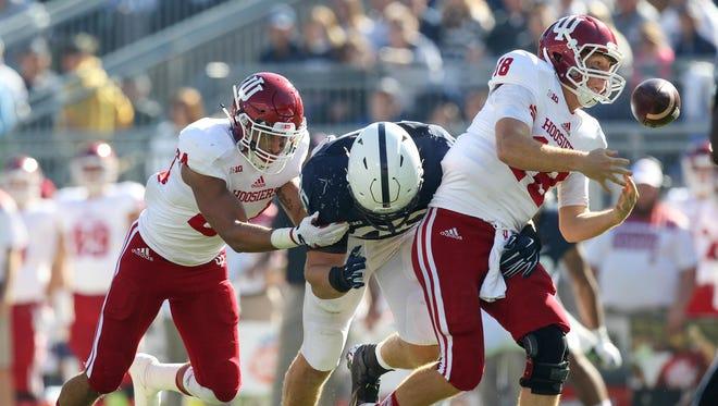 Indiana quarterback Danny Cameron fumbles the football against Penn State.