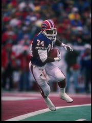 Then running back Thurman Thomas runs against the Dolphins.