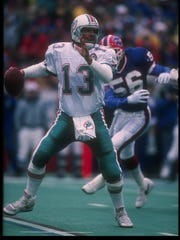Quarterback Dan Marino of the Miami Dolphins looks to pass during the Dec. 23, 1990, game.