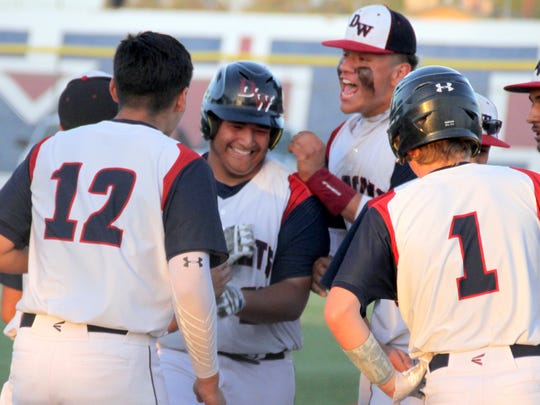 Junior designated hitter Jacob Morales is mobbed at