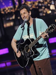 """Adam Sandler performs during Tuesday's episode of """"Late Show."""""""