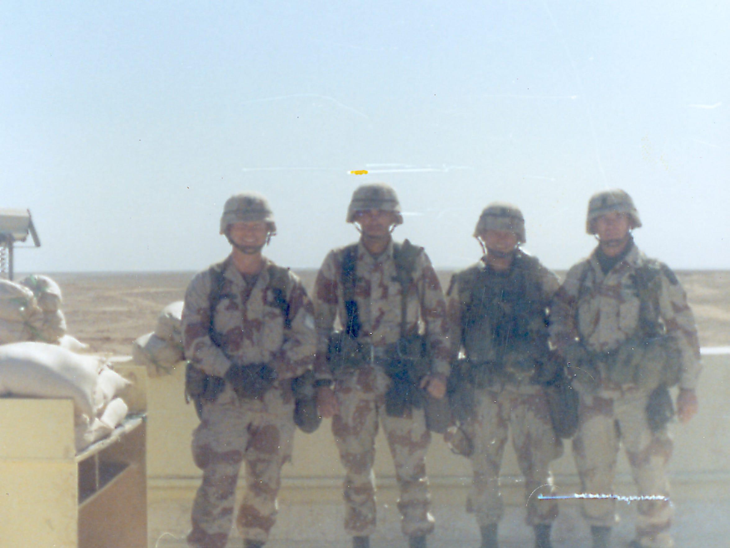 Command Sgt. Maj. Robert Nichols, left, Division Sgt.