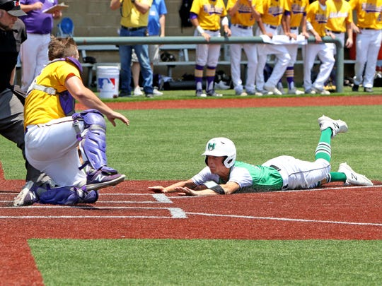 Godley's Brendan Davis tags Iowa Park's Kaleb Gafford in Game 2 of the Region I-4A finals Thursday, May 31, 2018, at Northwest High School in Justin.