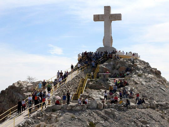 Pilgrims reach the base of the limestone cross atop Mount Cristo Rey near Sunland Park, N.M., on April 14, 2017 which is Good Friday. In earlier times, pilgrims from both sides of the border would visit the cross.