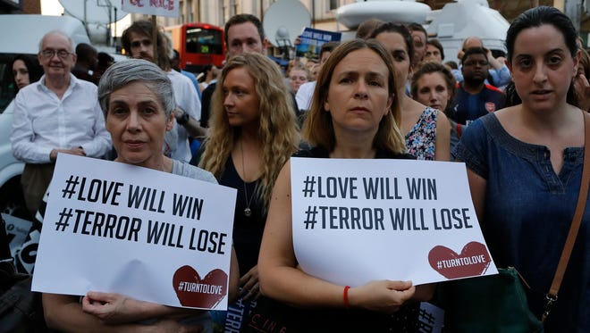 People take part in a vigil at Finsbury Park in north London, where a vehicle struck pedestrians in north London Monday, June 19, 2017. A vehicle struck pedestrians near a mosque in north London early Monday morning.