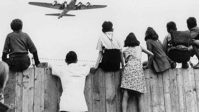 West Berlin children at Tempelhof airport watch fleets of U.S. airplanes bringing in supplies to circumvent the Russian blockade in this undated file photo. The airlift began June 25, 1948 and continued for 11 months.