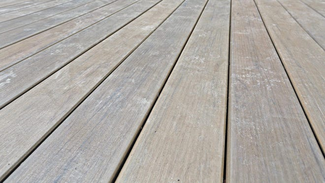 Composite decking like this can be cleaned before winter, but it doesn't need a coating like wood decks.