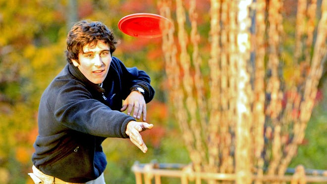 Allen Abbott plays disc golf, one of the more popular activities at the Outdoor Experience.