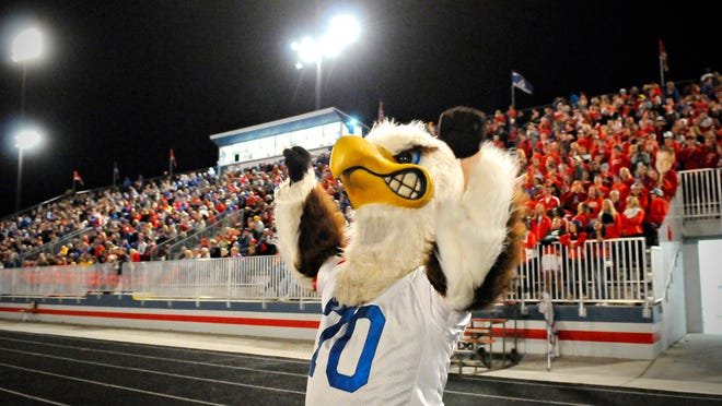 Apollo High School's mascot eagle gets the fans going during the football team's game against Sartell on Wednesday at Michie Field . North St. Cloud and St. Joseph are taking pride in the Apollo football team's back-to-back winning seasons for the first time since 1994-95.