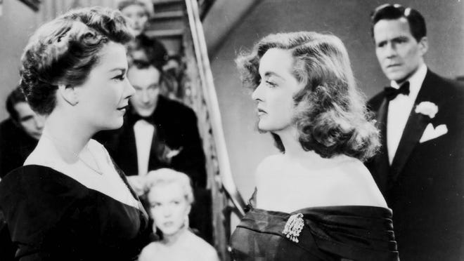 "Anne Baxter, left, and Bette Davis appear in a scene from ""All About Eve."""
