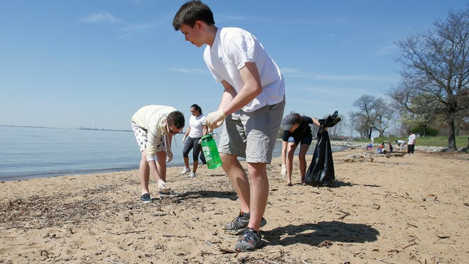 Addison Bolton (front) a University of Delaware sophomore from Denver, joins other members of the Alpha Phi Omega service fraternity including (from left) junior Dan O'Hara of Summit, N.J., and sophomores Dejuanah Collymore of Lancaster, Pa. and Grace Wood of Laurel during the Battery Park Clean-Up along the Delaware River in New Castle Saturday.