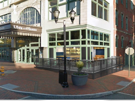 An artistic rendering of what a new corner bar and wrap-around patio could look like at The Queen.