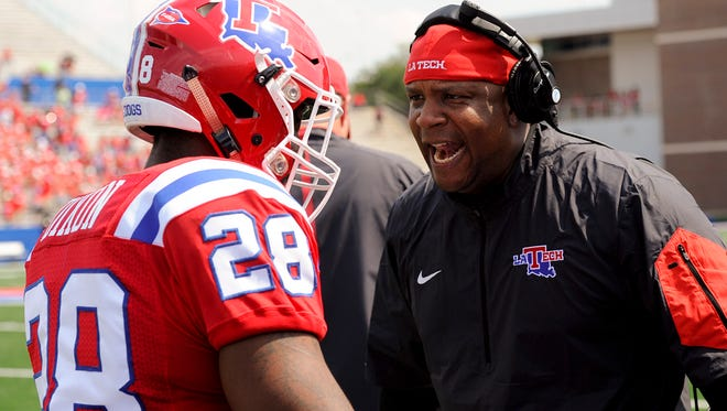 Louisiana Tech running backs coach Jabbar Juluke, right, and senior Kenneth Dixon, left, discuss a play in Saturday's game against FIU.