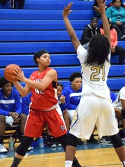 Riverheads' Alex Garcia looks to pass as Cumberland's Tayziana Booker defends during the first half of their Region 1A East girls basketball tournament consolation game on Saturday, Feb. 25, 2017, at Cumberland High School in Cumberland, Va.
