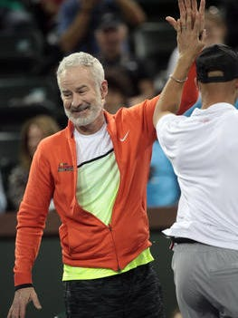 John McEnroe high-fives James Blake at The McEnroe Challenge for Charity event at Stadium 2 at the Indian Wells Tennis Garden in 2015.