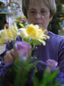 Adele Endicott, owner of Flower Corner, arranges flowers in this 2008 photo. Endicott is retiring after running the shop for nearly 25 years.
