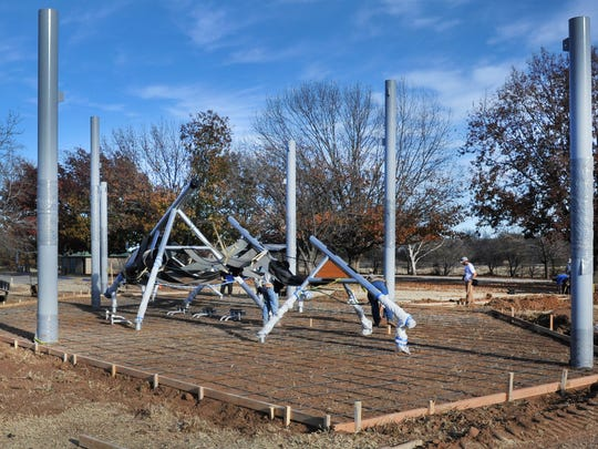 A new playground in Hamilton Park is seen Monday afternoon under construction. This addition to the city's parks system was a project of the Wichita County Medical Alliance.