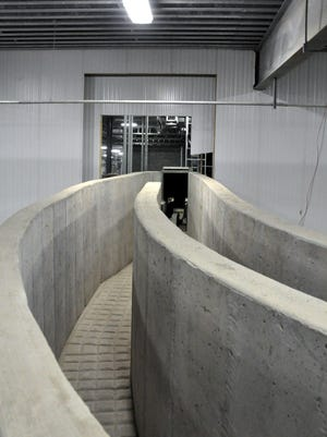 In this April 2, 2012 file photo, a concrete walled cattle path leads from an indoor stockyard into the Northern Beef Packers processing plant in Aberdeen.