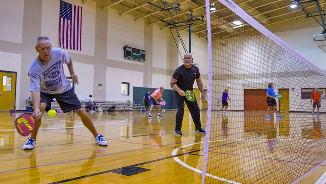 From left, Bob Schroeder and teammate Fred Franchi pair up during a pickle ball game at Estero Community Park Recreation Center.