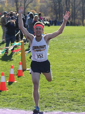 Celebrating his first-place finish at the NJCAA D-III nationals Saturday, Nov. 12, is Schoolcraft freshman Eric Wilkewitz.