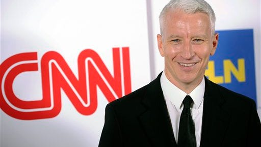 """FILE - In this Jan. 10, 2014 file photo, Anderson Cooper of CNN poses at the CNN Worldwide All-Star Party in Pasadena, Calif. CNN has joined Fox News Channel in saying that it was mistaken to report in the wake of an attack on the French newspaper Charlie Hebdo that there were neighborhoods in Europe considered """"no go"""" zones for non-Muslims.  (Photo by Chris Pizzello/Invision/AP, File)"""