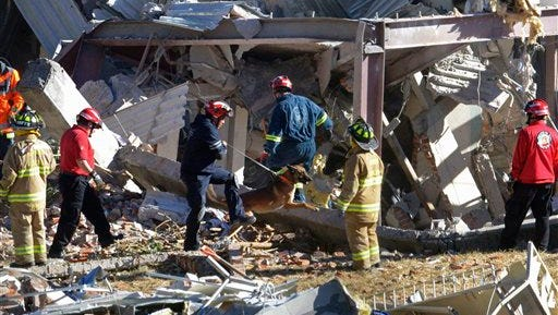 Rescue workers looking for survivors and trapped patients comb through the rubble of a hospital for mothers and children after a gas truck exploded in Cuajimalpa,  on the outskirts of Mexico City, on Thursday, Jan. 29, 2015.