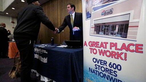 A sign at a recruiting station for Leslie's Pool supplies boasts that it is a great place to work during a National Career Fairs job fair in Chicago earlier this year.