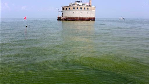 FILE - In this Aug. 3, 2014 file photo, the City of Toledo water intake crib is surrounded by algae in Lake Erie, about 2.5 miles off the shore of Curtice, Ohio. The U.S. Environmental Protection Agency officials Wednesday, May 6, 2015, released suggested thresholds that should prompt actions such as issuing do-not-drink warnings or taking steps to quickly reduce levels of two types of algal toxins. (AP Photo/Haraz N. Ghanbari, File)