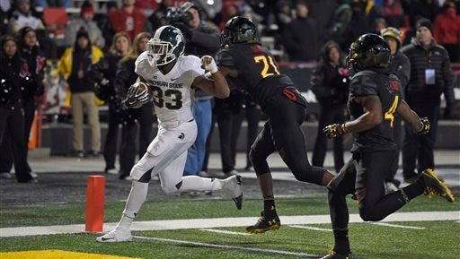 Michigan State running back Jeremy Langford (33) scores a touchdown during the Spartans' 37-15 win at Maryland last year, which also came after a gut-kicking defeat.