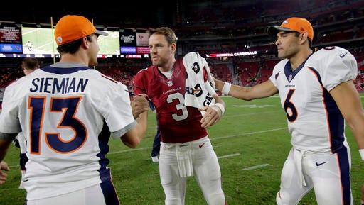 Arizona Cardinals quarterback Carson Palmer (3), Denver Broncos quarterback Trevor Siemian (13) and Broncos' Mark Sanchez (6) meet after an NFL preseason football game, Thursday, Sept. 1, 2016, in Glendale, Ariz. The Cardinals won 38-17. (AP Photo/Rick Scuteri)