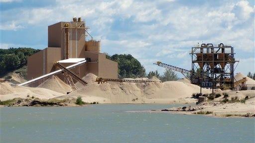 A Sept. 1, 2016, photo shows The Sargent Sand Company mine, a private inholding property inside Ludington State Park.