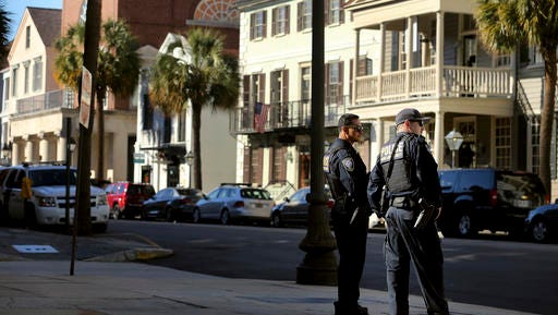 Homeland Security patrol the streets outside the Federal Courthouse Wednesday, Dec. 7, 2016, in Charleston,S.C., during  Dylann Roof's trial. Roof, a white man, is accused of killing nine black people at a church. (Grace Beahm/The Post And Courier via AP)