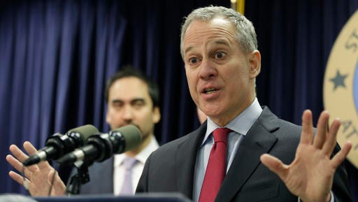 FILE- In this March 21, 2016 file photo, New York Attorney General Eric Schneiderman. Two weeks after officials in two dozen states asked Donald Trump to kill one of President Barack Obama's plans to curb global warming, Schneiderman was lead author on a rebuttal letter signed by Democratic attorneys general in 15 states, plus four cities and counties, asking the president-elect to save it.