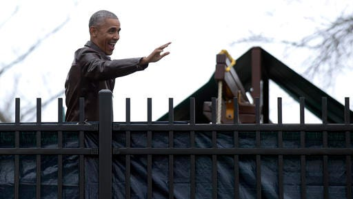 President Barack Obama waves to people in the community during a visit to the Jobs Have Priority Naylor Road Family Shelter in Washington, Monday, Jan. 16, 2017.