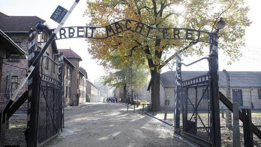 """FILE - This Oct. 19, 2012 file photo shows the entrance of Auschwitz at the former Nazi German death complex of Auschwitz-Birkenau in in Oswiecim, Poland. The memorial museum is asking Germans and Austrians to donate private letters, memoirs, photos and any other items that could help historians better understand the mentality of the Holocaust's perpetrators. The museum said Wednesday, Jan 18, 2017, it seeks """"to better understand the influence of populist mechanisms of hatred for human beings."""""""