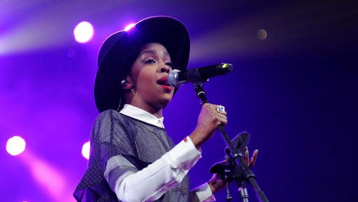 "FILE - This Feb. 5, 2014 file photo shows singer Lauryn Hill performing at Amnesty International's ""Bringing Human Rights Home"" Concert in New York. Hill took the stage in Pittsburgh, on Tuesday, Jan. 31, 2017, more than three hours late."