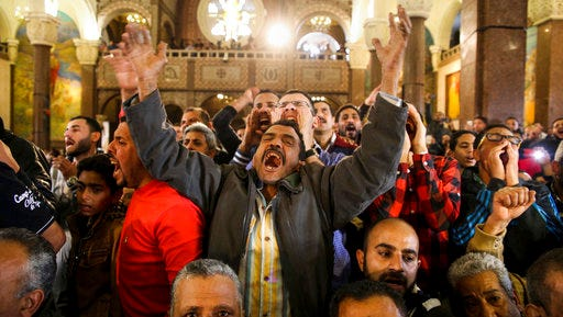 Men react during the funeral for those killed in a Palm Sunday church attack in Alexandria Egypt, at the Mar Amina Church, Monday, April 10, 2017. Egyptian Christians buried their dead on Monday, a day after Islamic State suicide bombers killed at least 45 people in coordinated attacks targeting Palm Sunday services in two cities.
