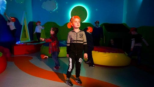 This March 29, 2017 photo shows Ryan Cunningham in the Sensory Room at Shannon Airport in Shannon, Ireland. Shannon is one of several airports offering quiet rooms for travelers on the autism spectrum.