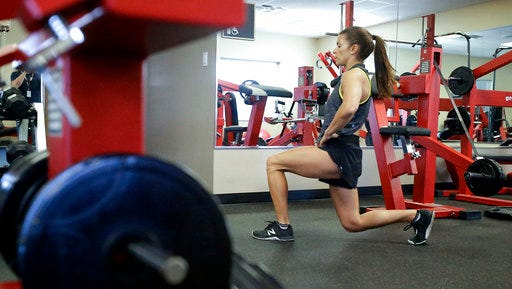 In this Saturday, Feb. 18, 2017, photo, Danica Patrick works out at Daytona International Speedway, in Daytona Beach, Fla. Patrick is really serious about health and clean eating, and as her driving days may be nearing an expiration date, a second career in lifestyle and fitness could be up next.