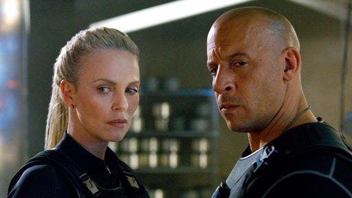 "This image released by Universal Pictures shows Charlize Theron, left, and Vin Diesel in ""The Fate of the Furious."""