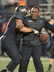 Vanderbilt head coach Derek Mason and Vanderbilt punter