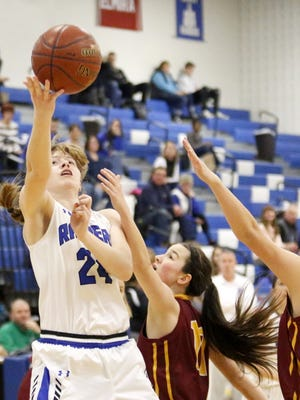 Jillian Casey puts up a scoop shot for Horseheads against Ithaca on Feb. 1 at Horseheads Middle School.