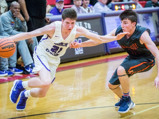Central's Dylan Stafford drives against Lafayette Harrison