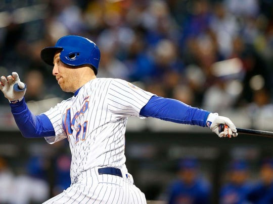 Apr 16, 2018; New York City, NY, USA; New York Mets third baseman Todd Frazier (21) follows through on a double iduring first inning against the Washington Nationals at Citi Field.