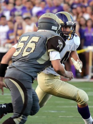 Clarkstown North's Michael Porco runs the ball at Clarkstown South on Sept. 4, 2015.