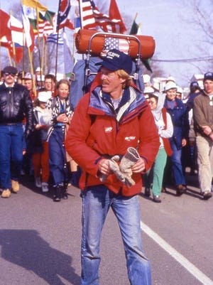 """""""Worldwalker"""" Steven Newman receives a hero's welcome in his hometown of Bethel at the 1987 conclusion of his world trek."""