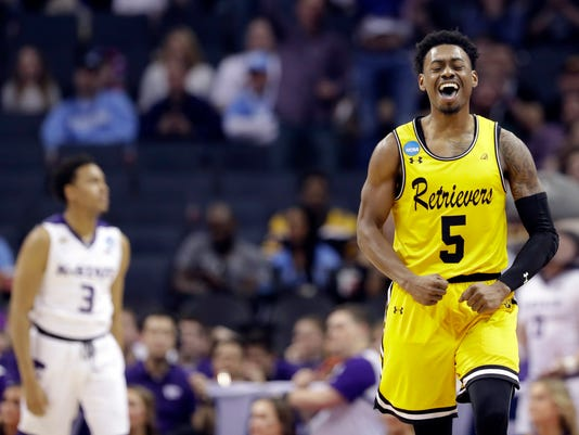 UMBC's Jourdan Grant (5) celebrates after a basket against Kansas State during the second half of a second-round game in the NCAA men's college basketball tournament in Charlotte, N.C., Sunday, March 18, 2018. (AP Photo/Gerry Broome)
